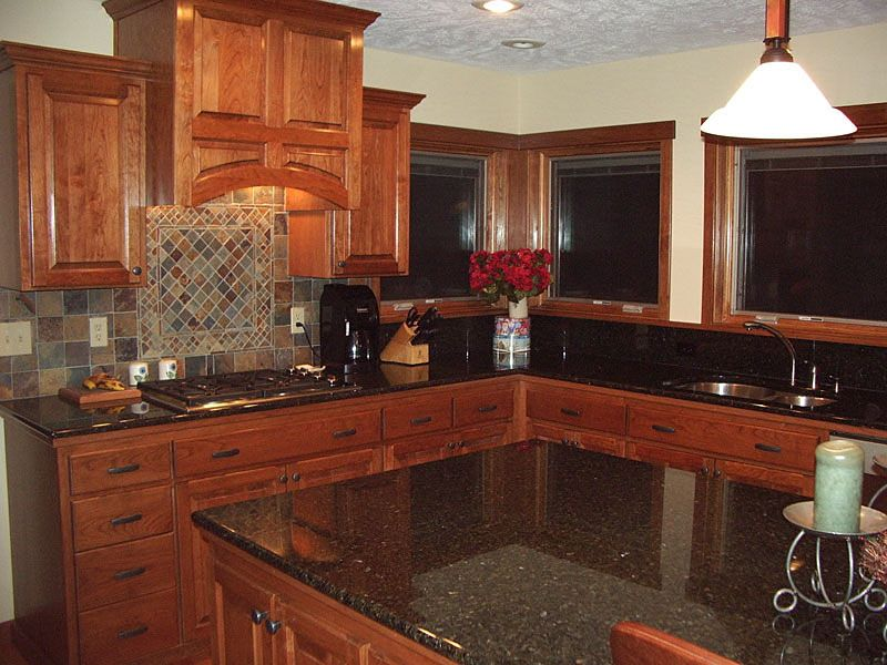 Cherry Wood Cabniets With Black Granite I Like The Stone Backsplash Again Also