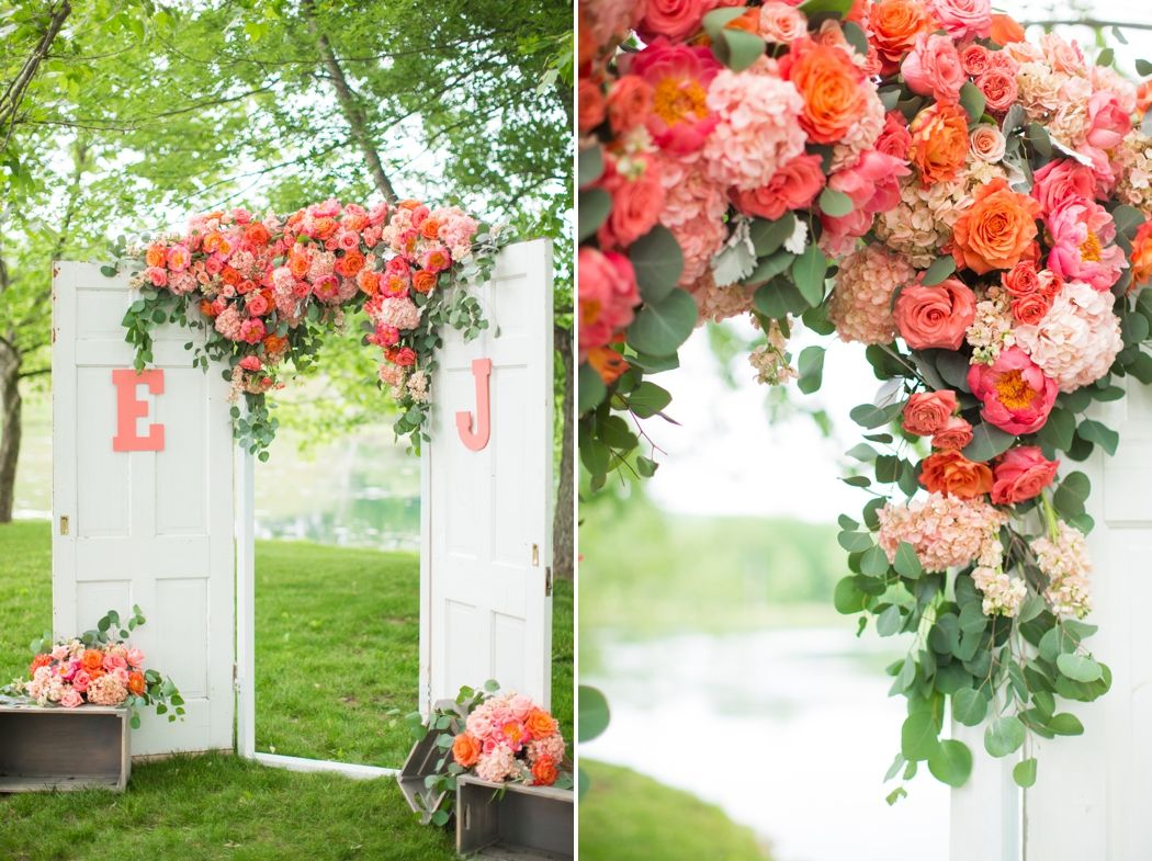 Vintage Monogrammed Doors With Flowers For A Wedding Ceremony