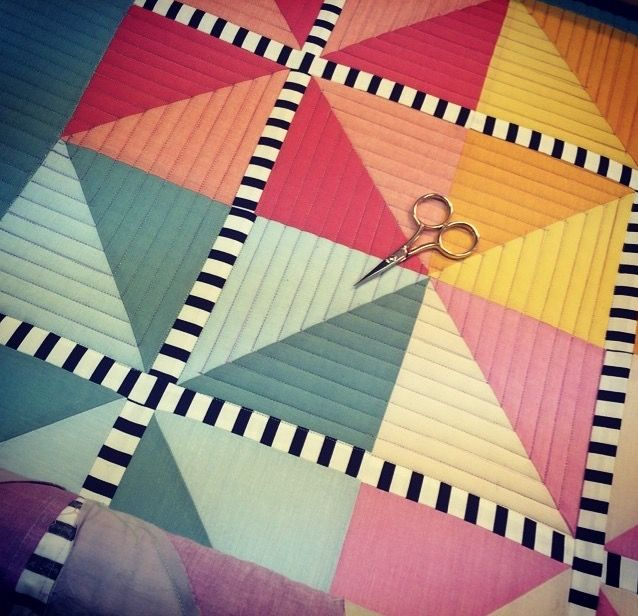 """I see some definite quilty inspiration in this """"Pepper Cory's Peppered Cottons"""" quilt detail by Karen McTavish. I love the solids combined with the b/w stripe!"""