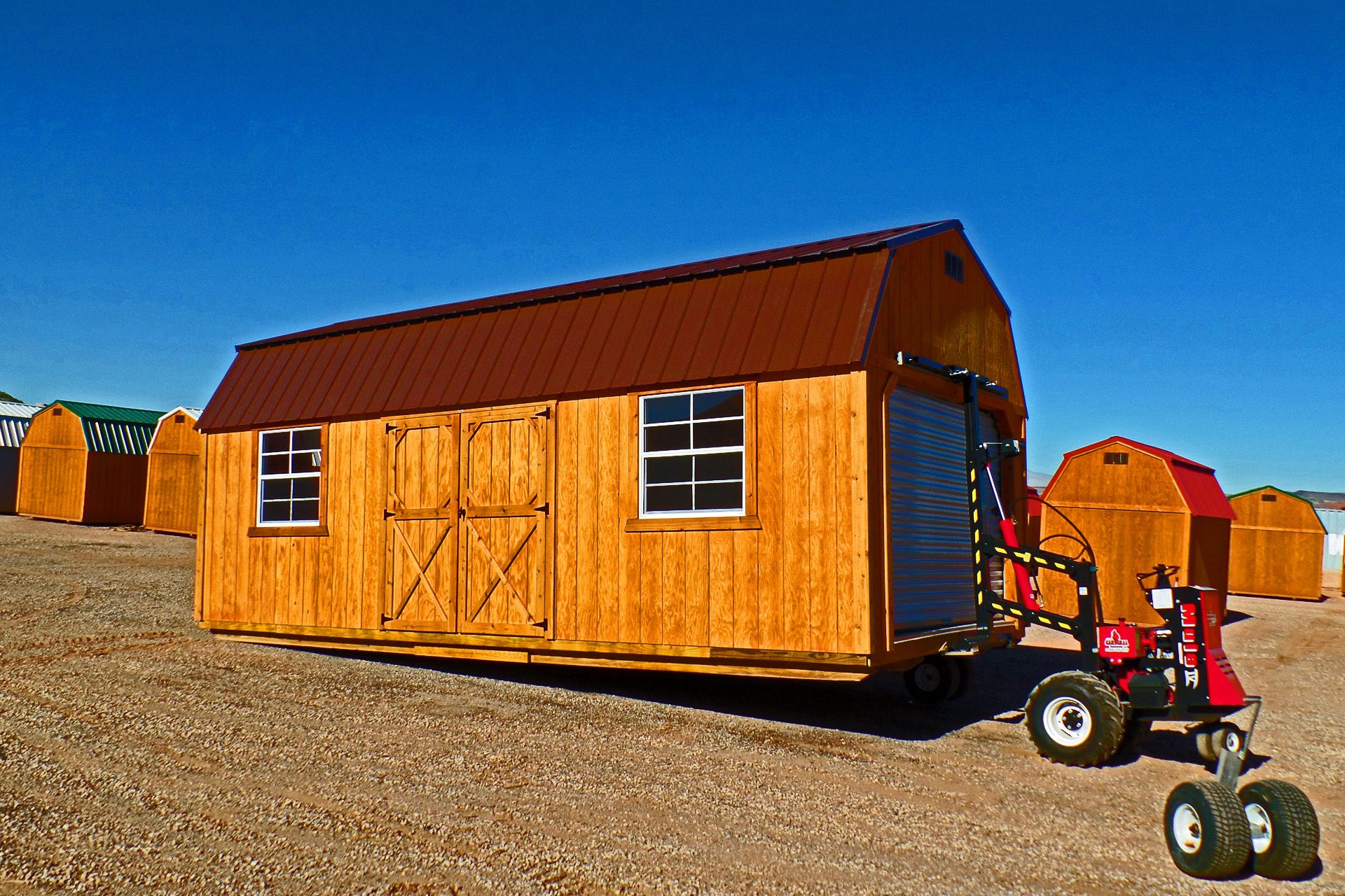 This custom Lofted Barn, with an added garage door, is ...