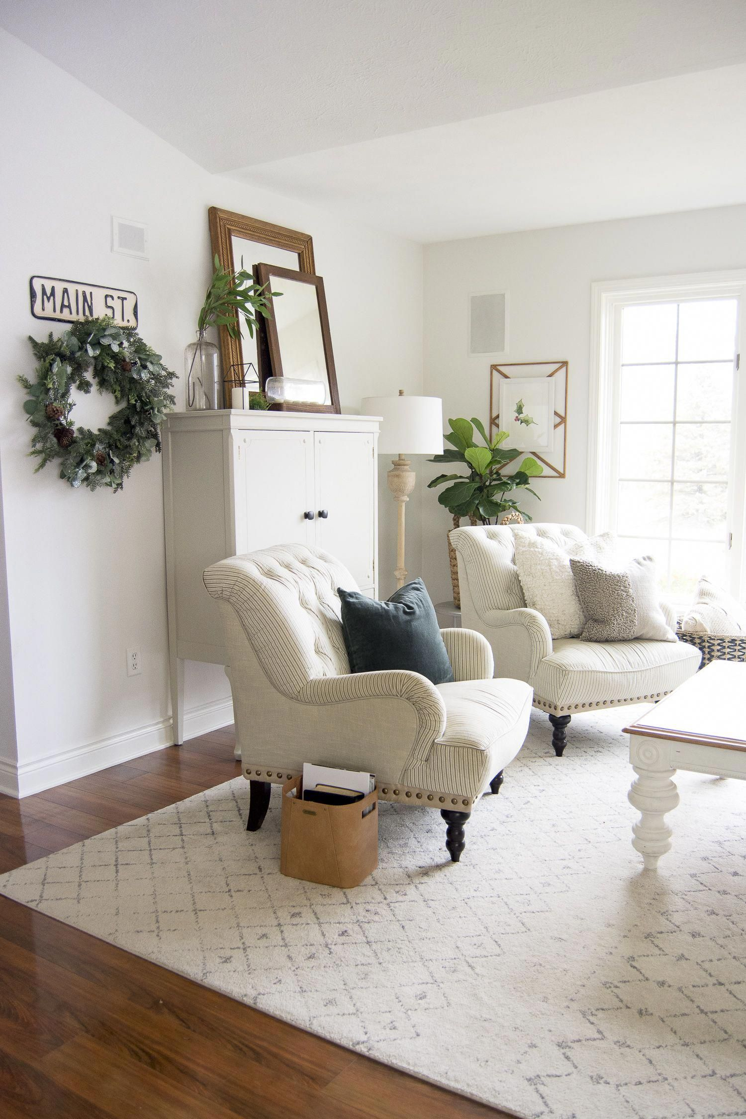 The hygge movement of intentional coziness is in full swing! On the blog I'm sharing cozy living room ideas that you can incorporate on a budget!  #fromhousetohaven #cozylivingroom #livingroomideas #hyggehome #hyggedecor
