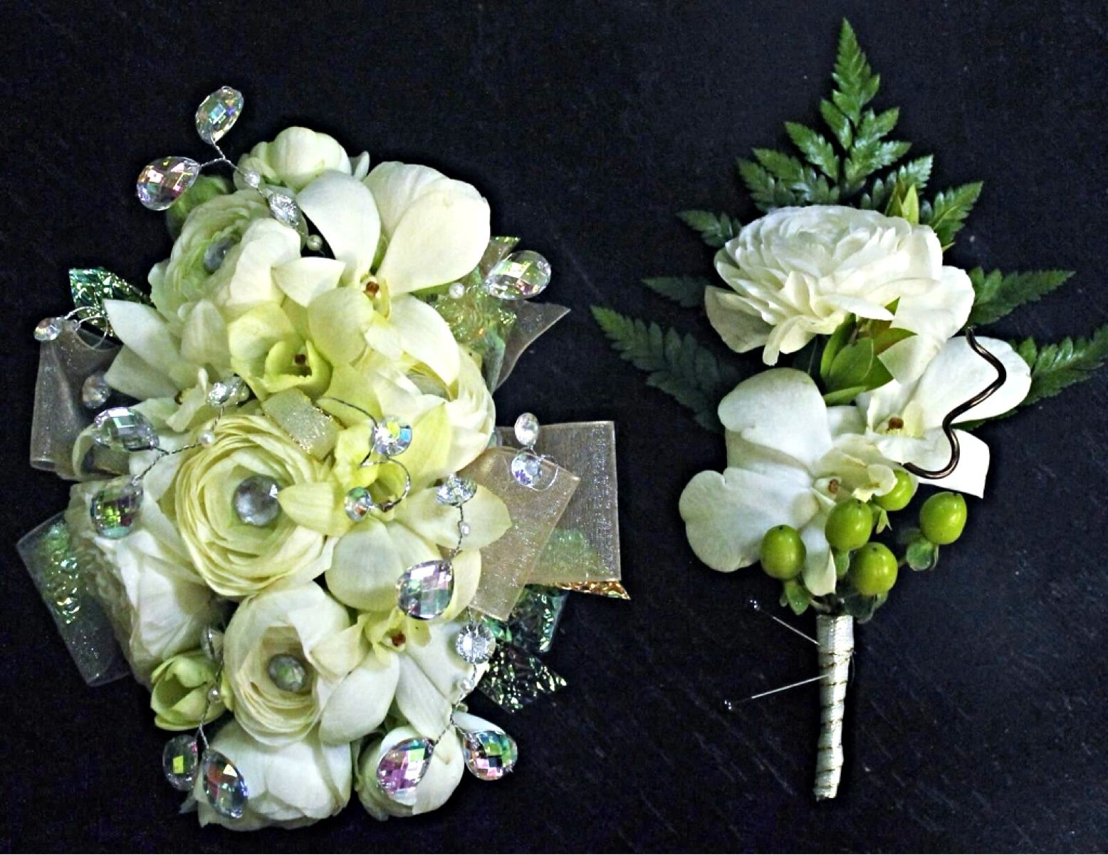Beautiful corsage and boutonnière using ranunculus and orchids. #2floristgirls #floristofrowlett