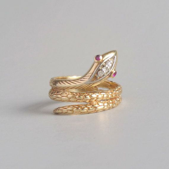 Gold Snake Ring from the 1940s. Made from 18k gold with a diamond head    ruby eyes. Offered by The Deeps on Etsy. f9fec694c834