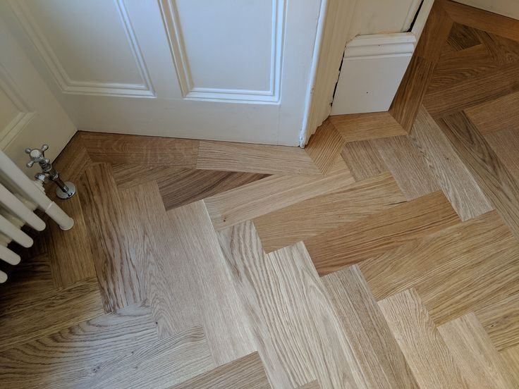 Mitred corners crafted in the single border. Oak parquet