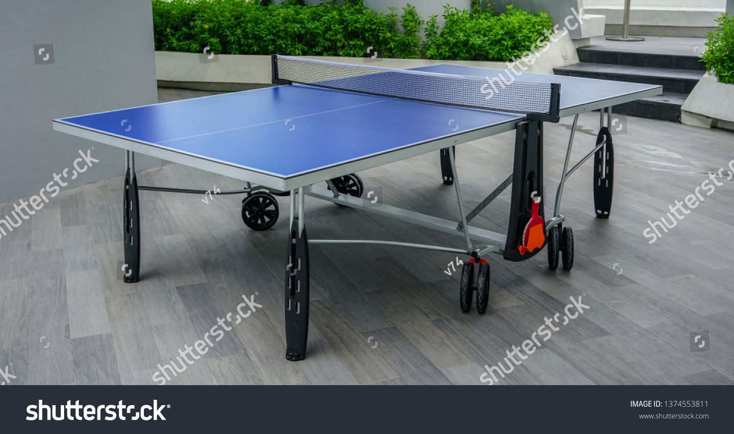 Blue Table Tennis Table On Wooden Floor Ping Pong Table On