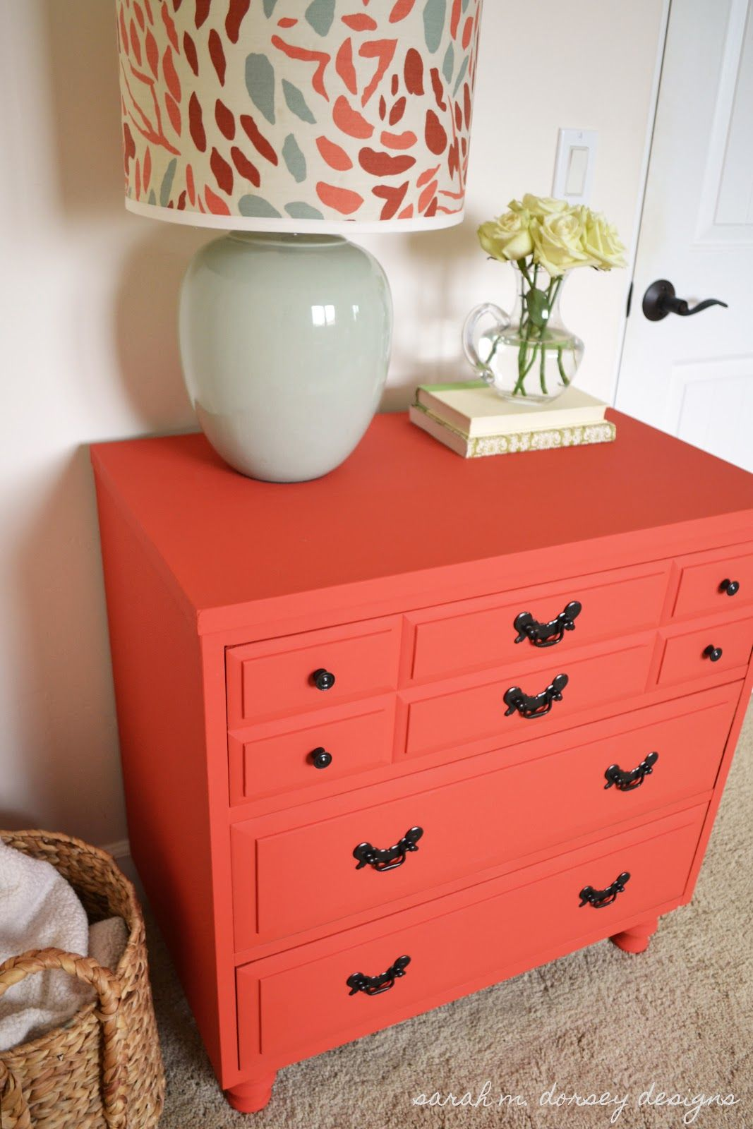coral dresser, black handles and knobs. What a fun pop of color ...