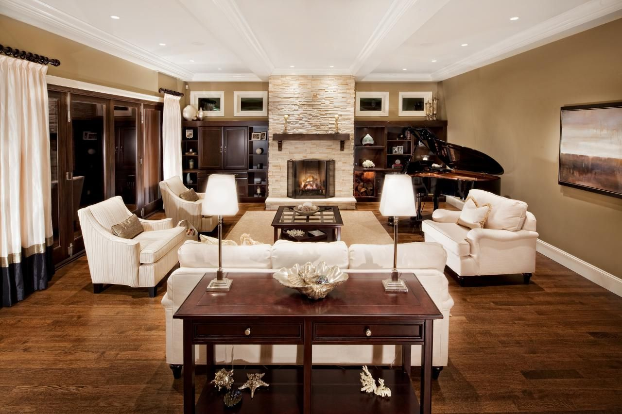 The white sofas against the rich woods