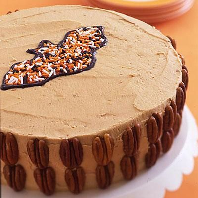 Decorate a store-bought or homemade cake. Place a bat-shape cookie cutter in the center and fill with sprinkles; outline the bat with icing gel. Easy!