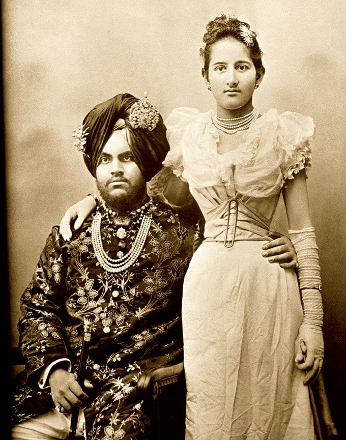 Maharaja Jagajit Singh (b. 1872, r. 1877-1949) And Rani Kanari of Kapurthala, c. 1890 The young Maharaja and his wife pose for the photograph in an unusually intimate pose unlikely to have been taken in India. Maharaja Jagatjit Singh's penchant for everything European was to extend to the sartorial choices of his wife, who is seen wearing a tightly corseted gown and long silk gloves.