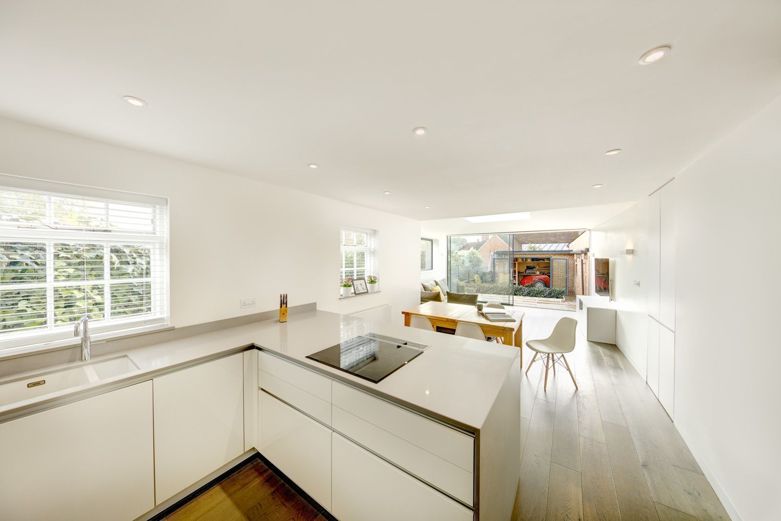 Long linear open plan kitchen/dining/living area with Licht kitchen ...