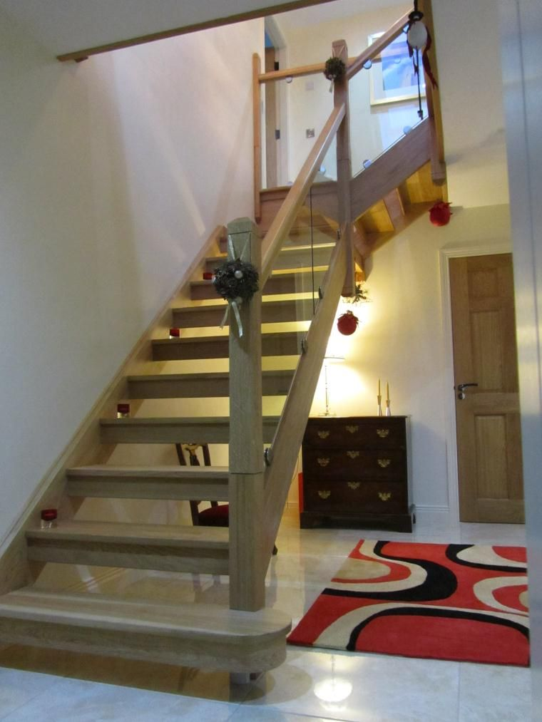 White Oak Staircase With Open Risers And Glass Balustrade