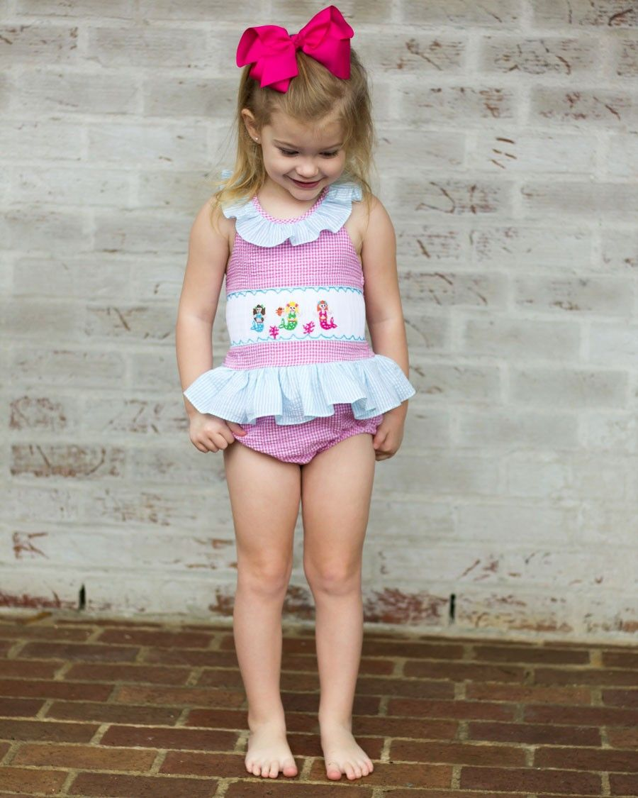 628c8dfa16347 Mermaid Smocked Seersucker Swim Suit - She'll ride the waves in our hot  pink gingham swim suit with smocked mermaids across the top.