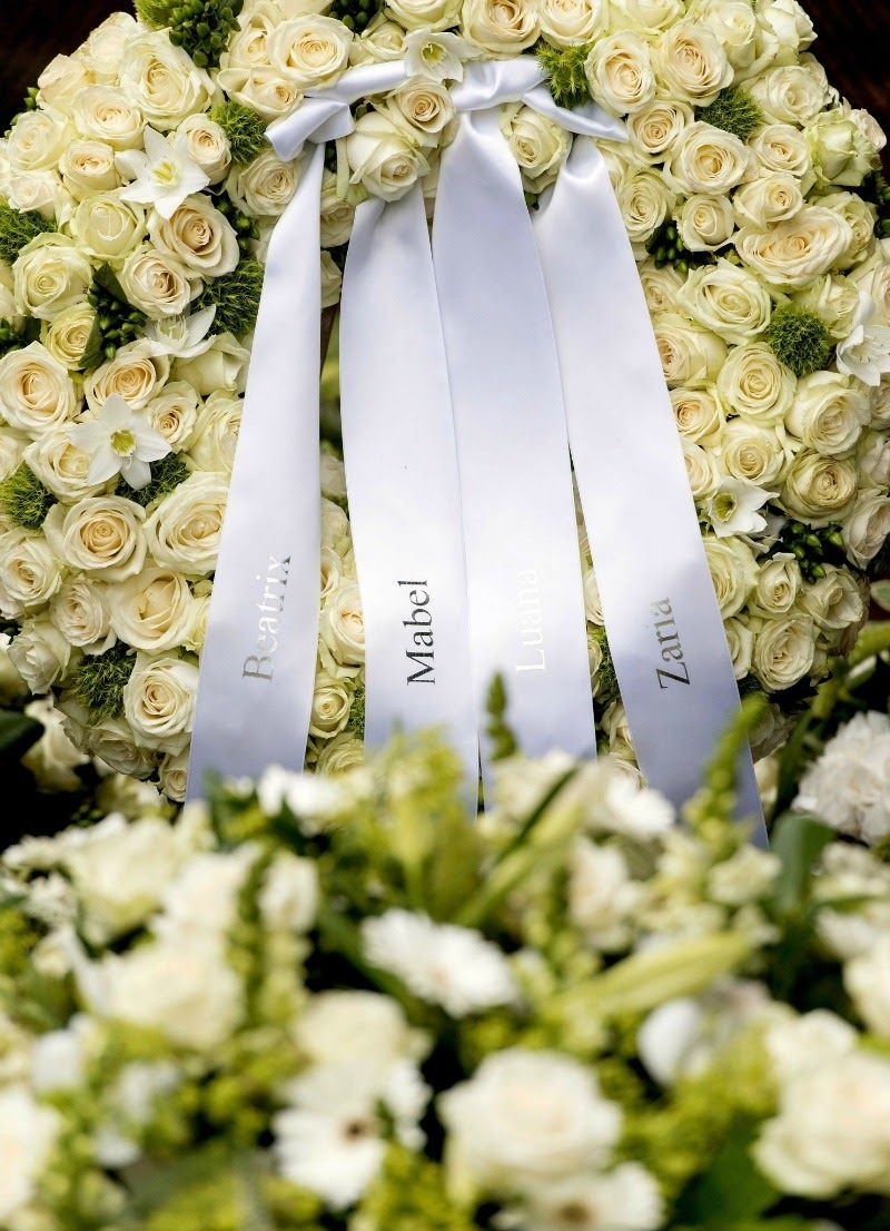 Funeral of prince friso at the stulpkerk in lage vuursche floral tributes are left next to the grave of prince friso of the netherlands after his funeral ceremony at the stulpkerk church on 16 aug 2013 in lage dhlflorist Choice Image