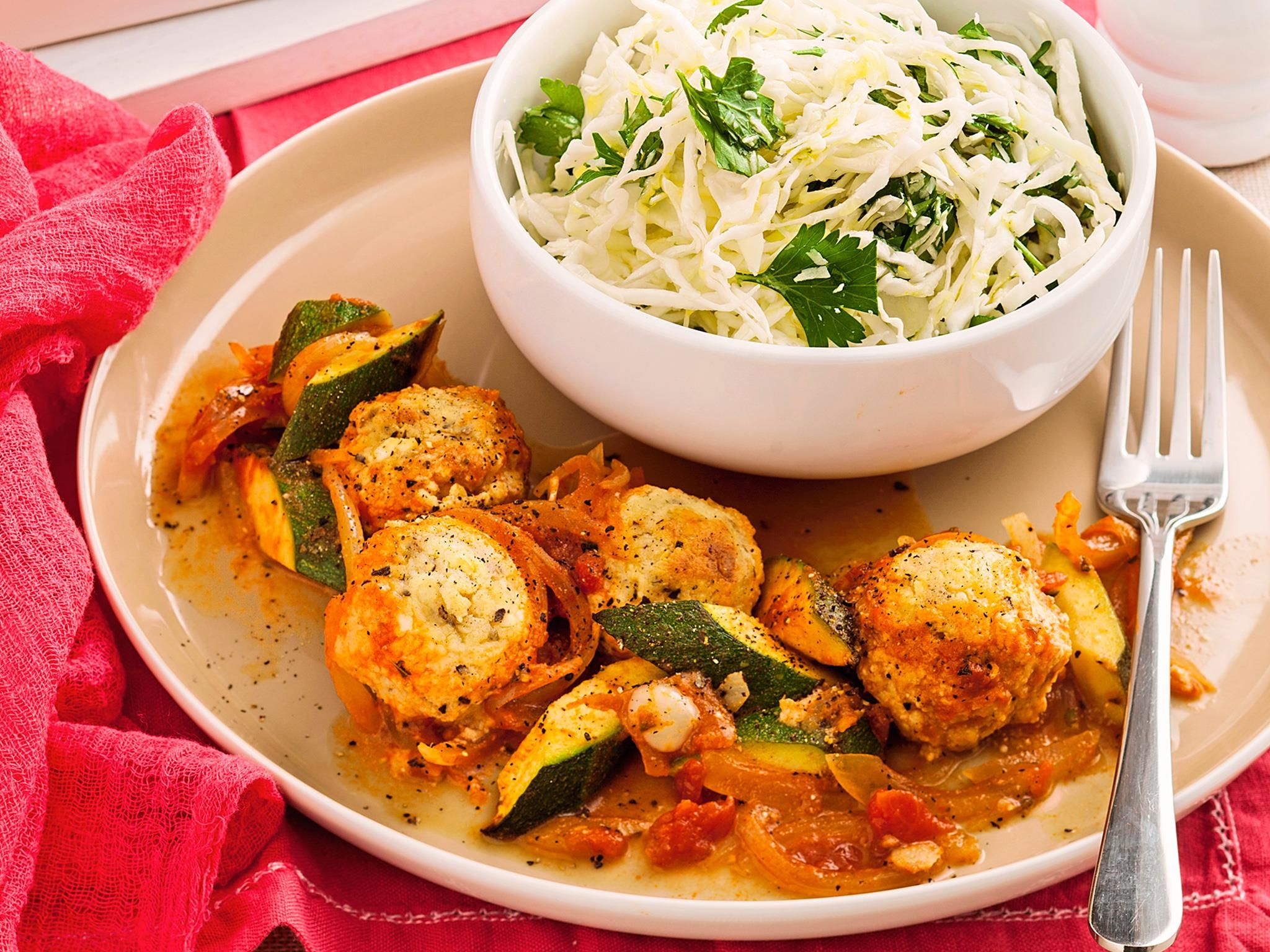 This is a wonderful vegetarian recipe with cheesy balls served on sautéed zucchini and a side of Italian coleslaw, a steal at just $4.15 per serve