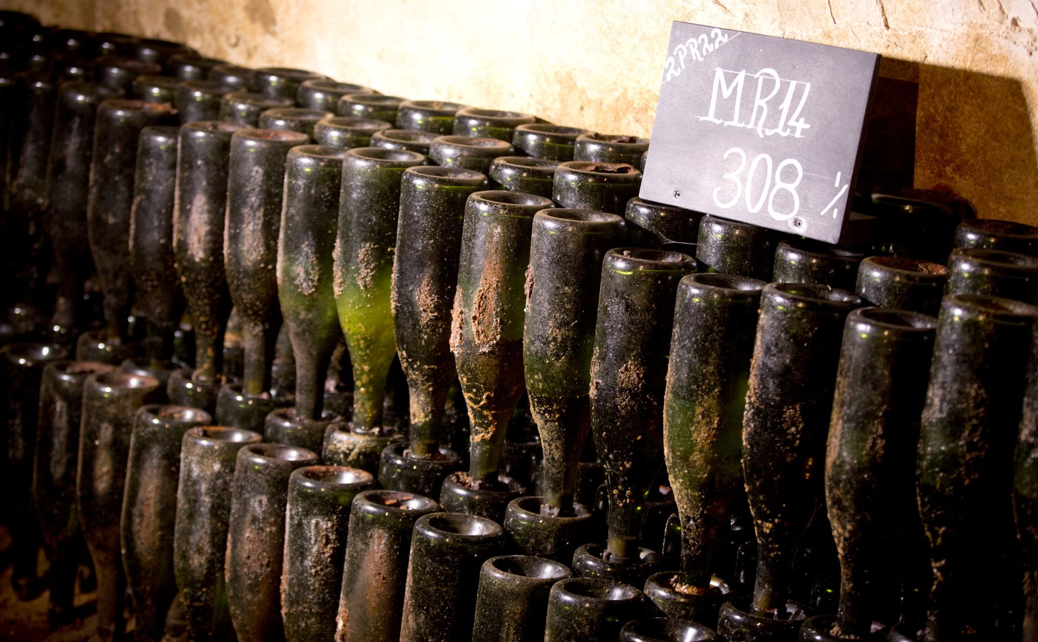 Bottles of 1914 Pol Roger champagne are stacked neck down in the cellars of the Pol Roger Champagne ... - AP Photo/Virginia Mayo
