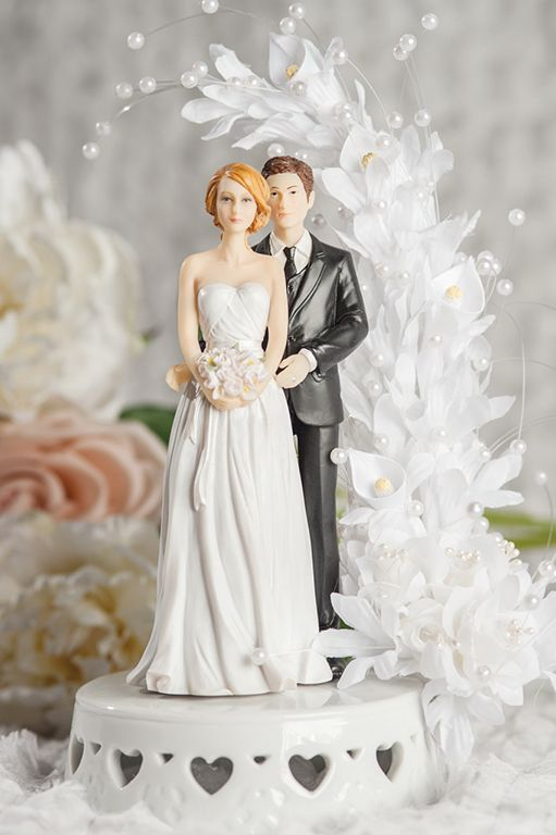 African american groom holding caucasian bride interracial cake topper