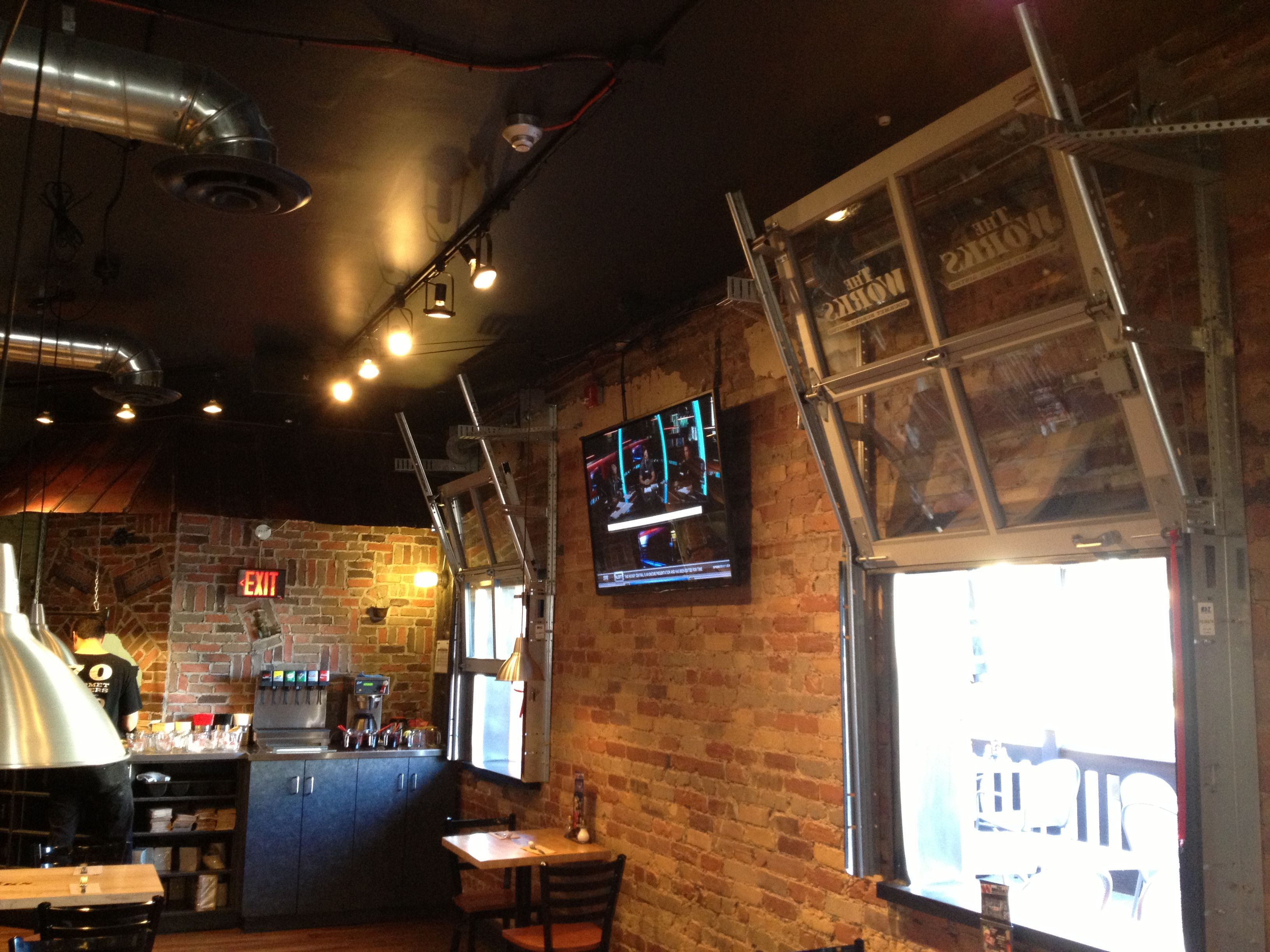 Tv Wall Mounted Against Exposed Brick Wall Tv Wall Mount Installation Tv Wall Wall Mounted Tv