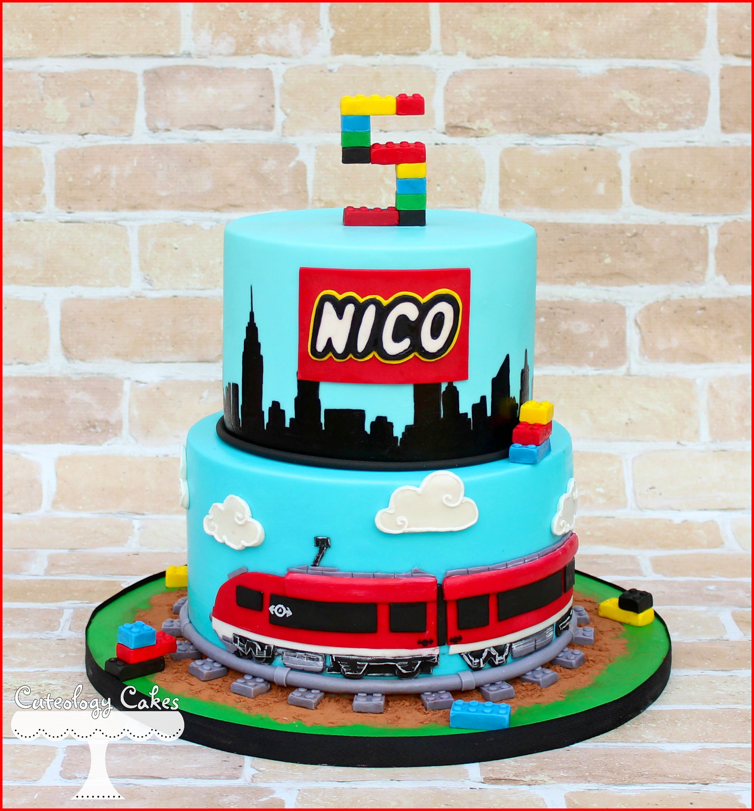 Lego City Themed Cake With Train Tracks And Skyline Silhouette