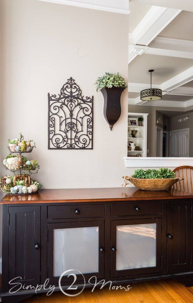 Get simple ideas to decorate your home for Spring using greenery, flowers, and neutral decor with this Spring Home Tour. Then connect with 12 more bloggers for more Spring decor inspiration! | decorate above kitchen cabinets with greenery #frontentry #fireplace #frontporch #kitchen #familyroom #livingroom #mantel #mantle #centerpiece