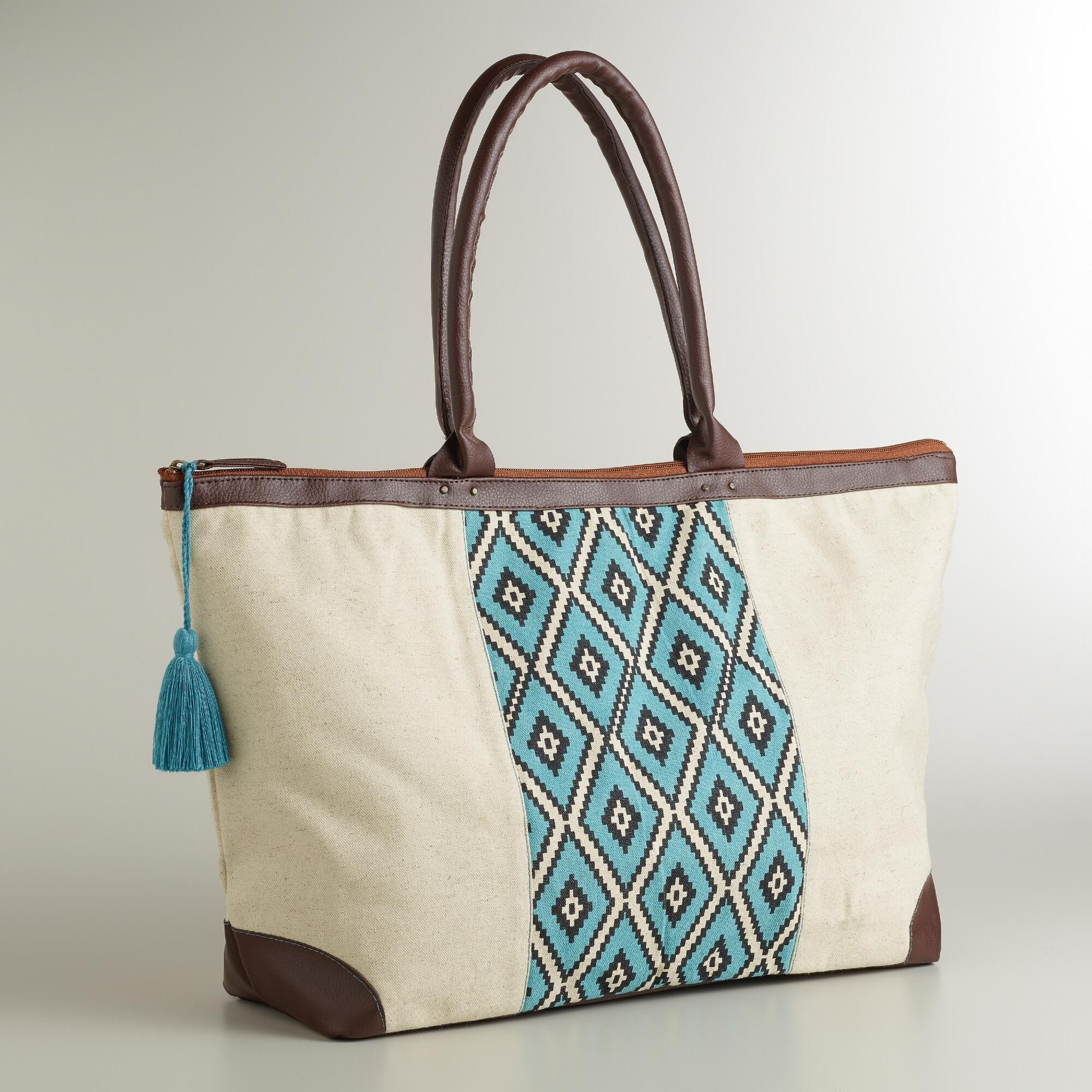 d4127550e1 Pack for your next getaway in style with our modern weekend tote bag.      WorldMarket Mother s Day