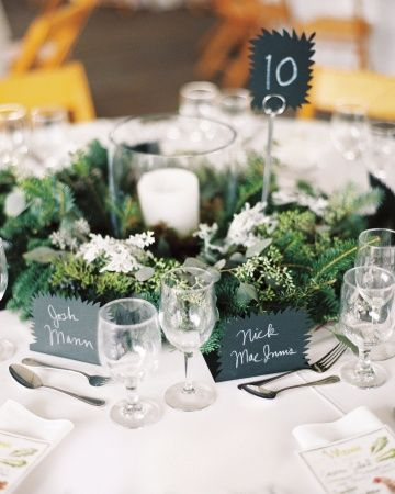 Hurricane Vases Filled With Moss And A Candle Surrounded By Fresh Greenery Wedding Centerpieces Green Wedding Centerpieces Wedding