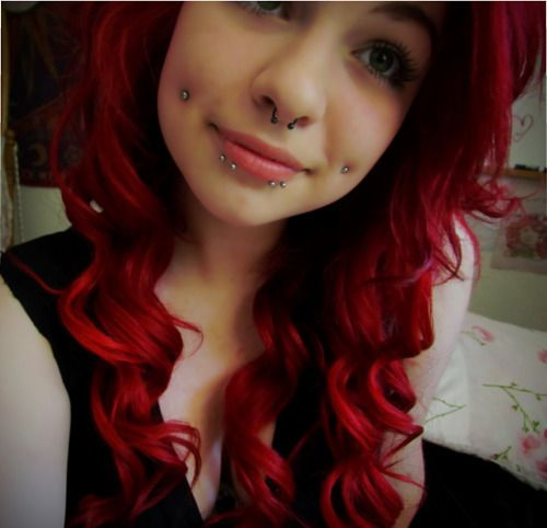 her piercings are really cute. dimples, septum, and double snakebites. #piercings #grunge