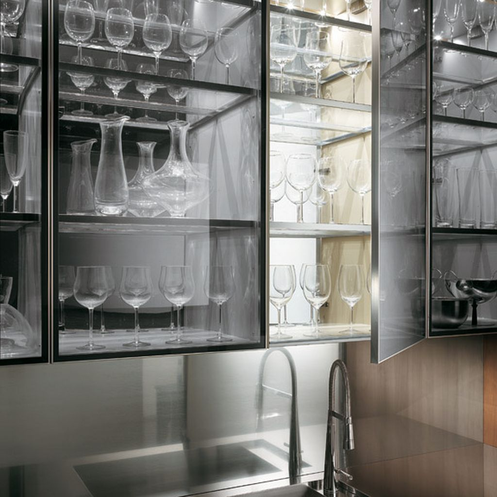 transparent glass cabinet with a kitchen faucet in a natural