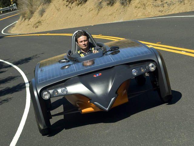Venturi Automobile's owner Gildo Pastor at wheel of Astrolab solar car.