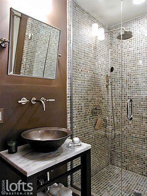 Love the mosaic shower and dark chocolate brown walls!
