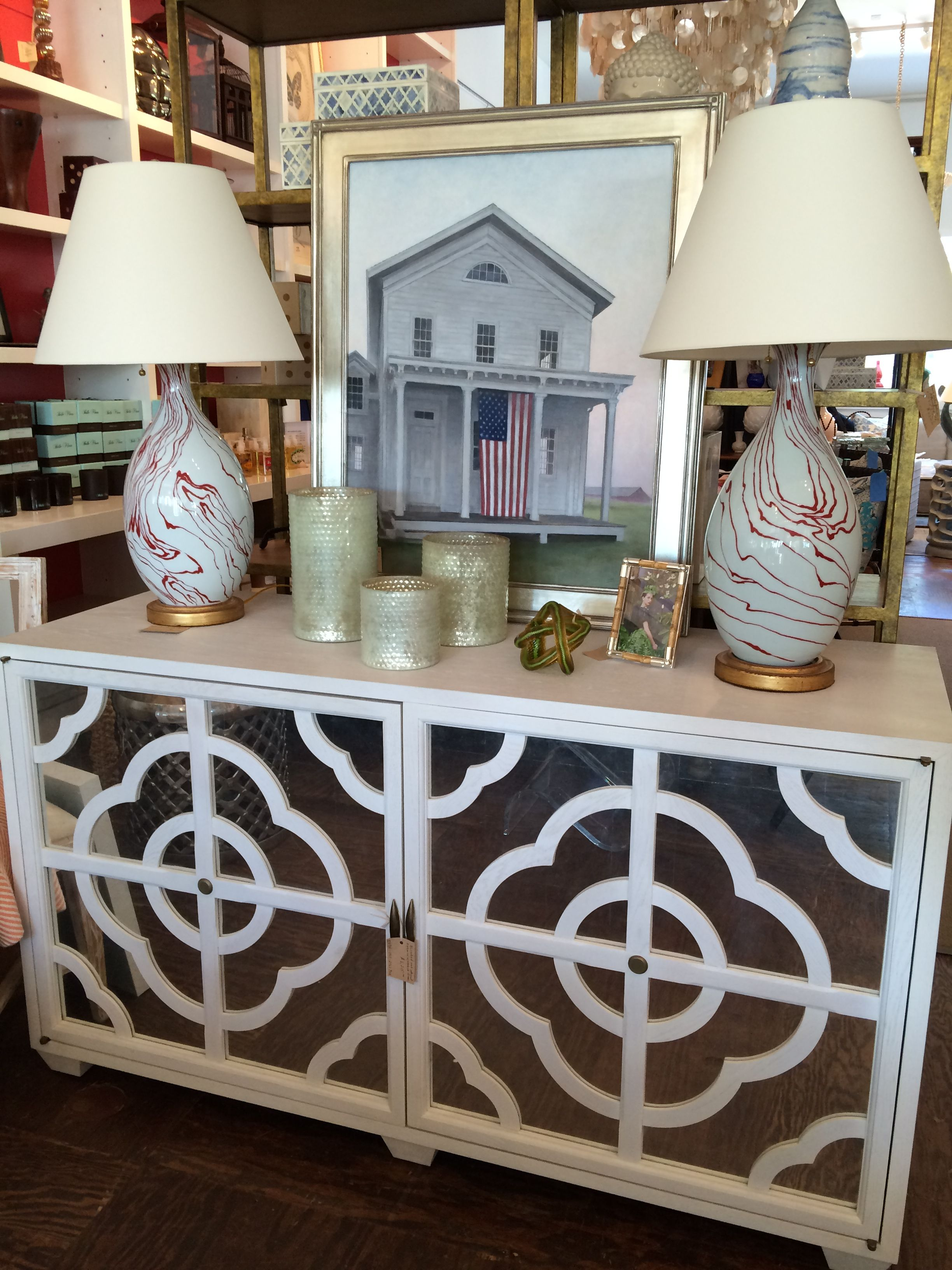 oak mirrored cabinet with table lamps framed americana painting