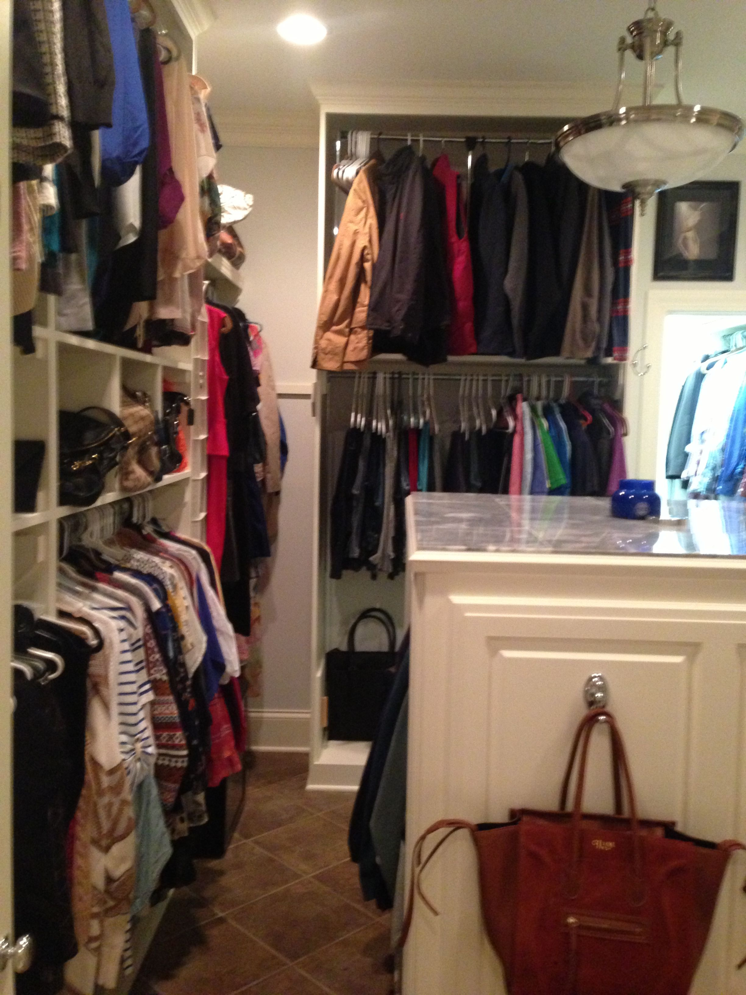 Our huge master bedroom walk-in closet/ shelves/ shoes/ seating/ marble/ Avery Gardens in Jackson, Mississippi