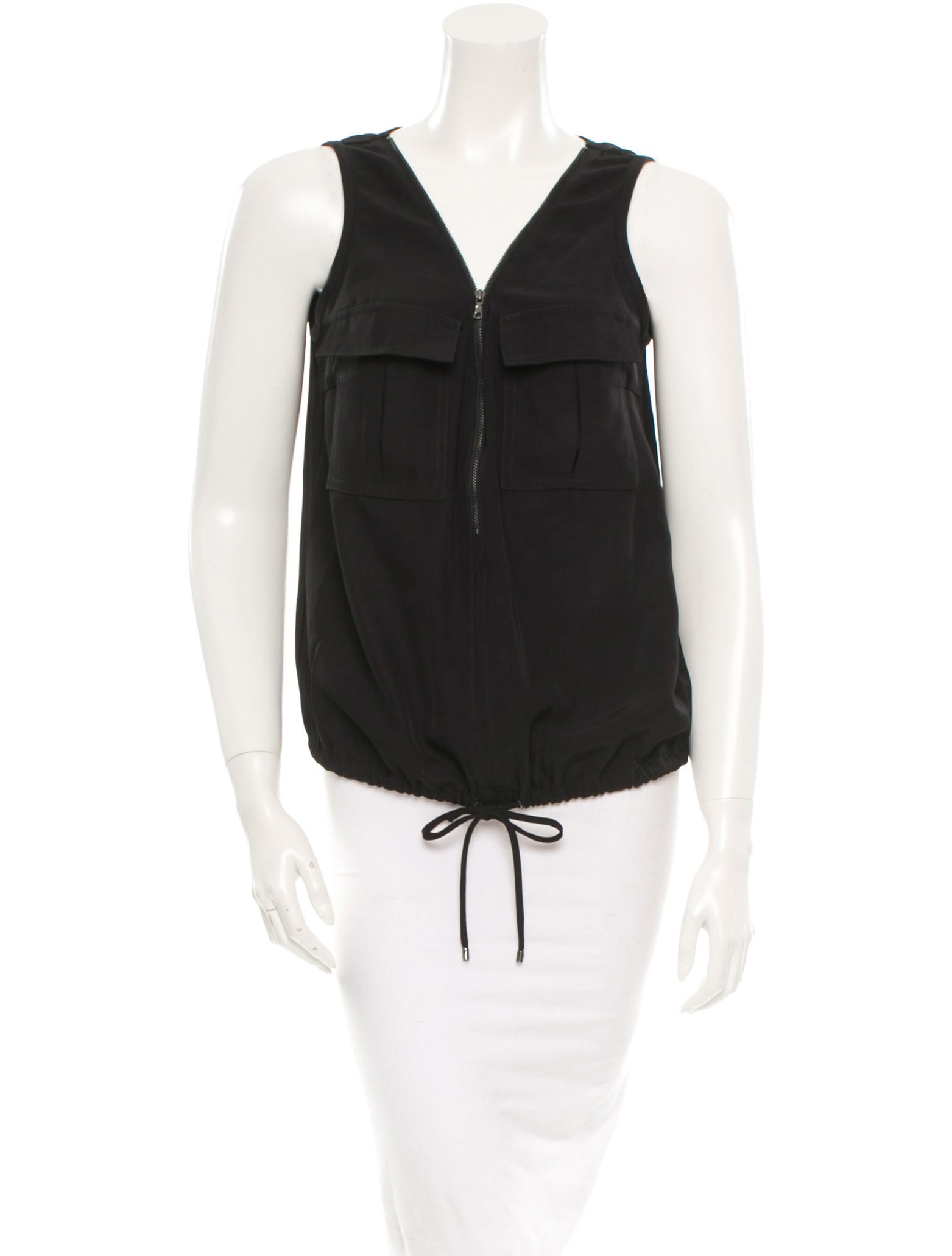 Black Trina Turk sleeveless top with two pockets at bust, thick straps, V-neck featuring exposed zip closure and drawstring closure at waist.