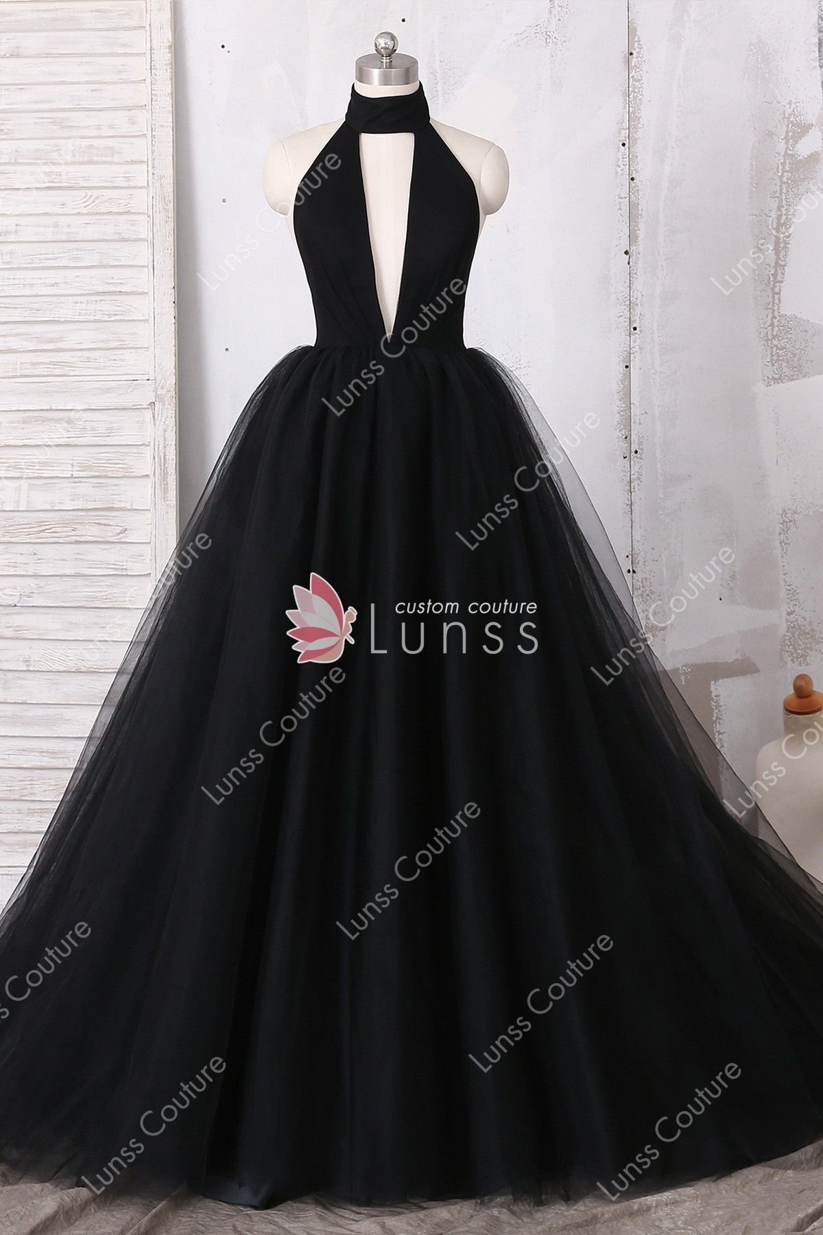 6d7edc7a107 This gorgeous black tulle puffy long prom dress features timeless ball gown  silhouette
