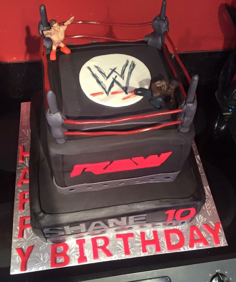 WWE -Raw Cake - chocolate cake filled with buttercream covered with buttercream icing and buttercream fondant with candy and buttercream fondant details made by me at Sugared Dreams Cakes & Bakes #wwe #raw #wrestlingcake