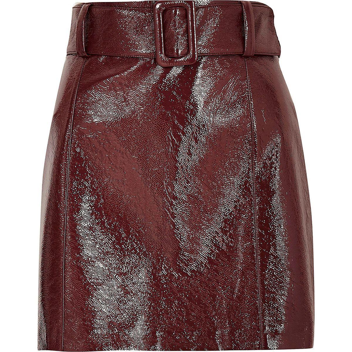 f4f551c34 Burgundy vinyl belted mini skirt. Burgundy vinyl belted mini skirt River  Island Skirts ...