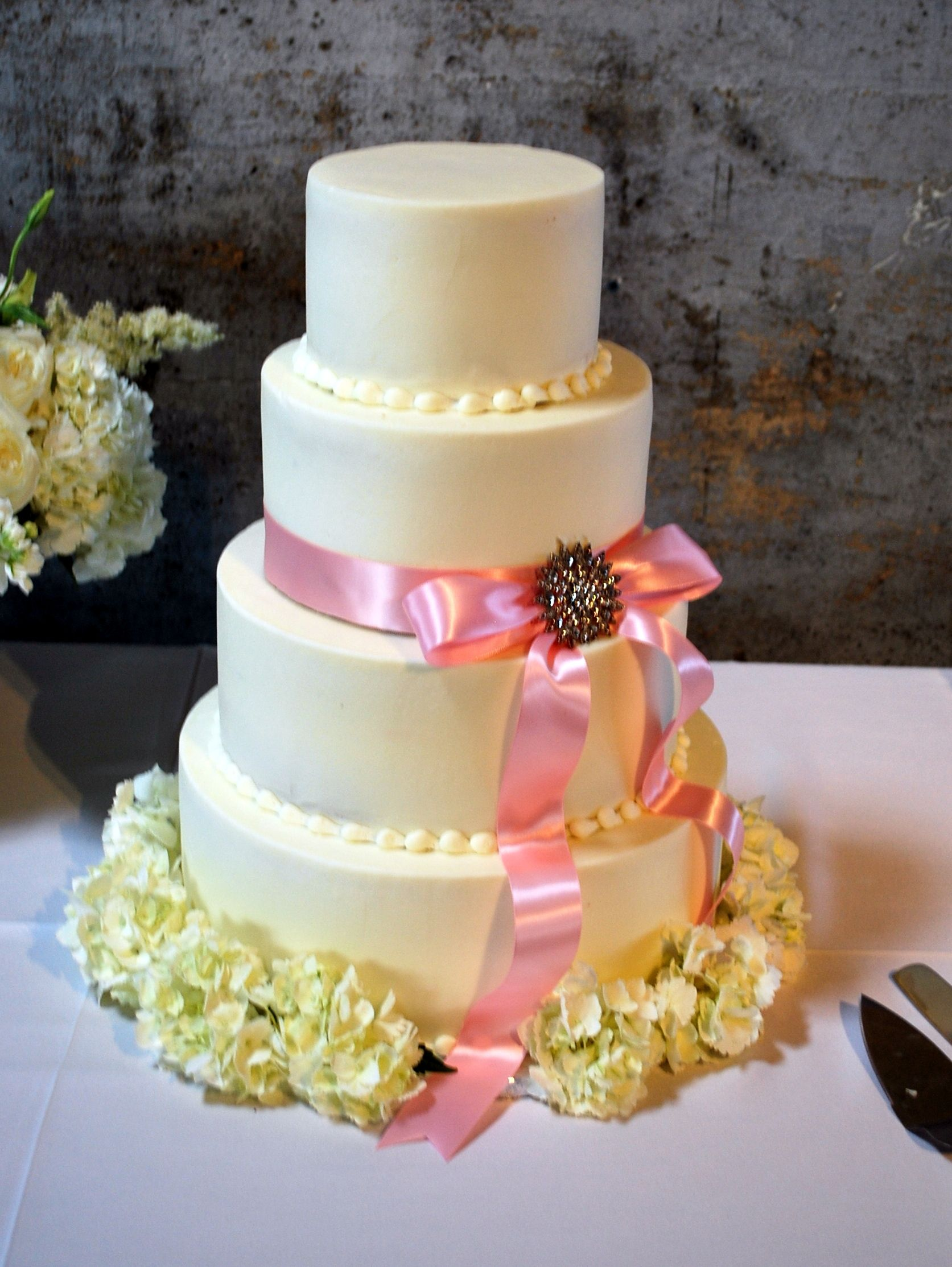 Simple Wedding Cake, Broach and Ribbon.