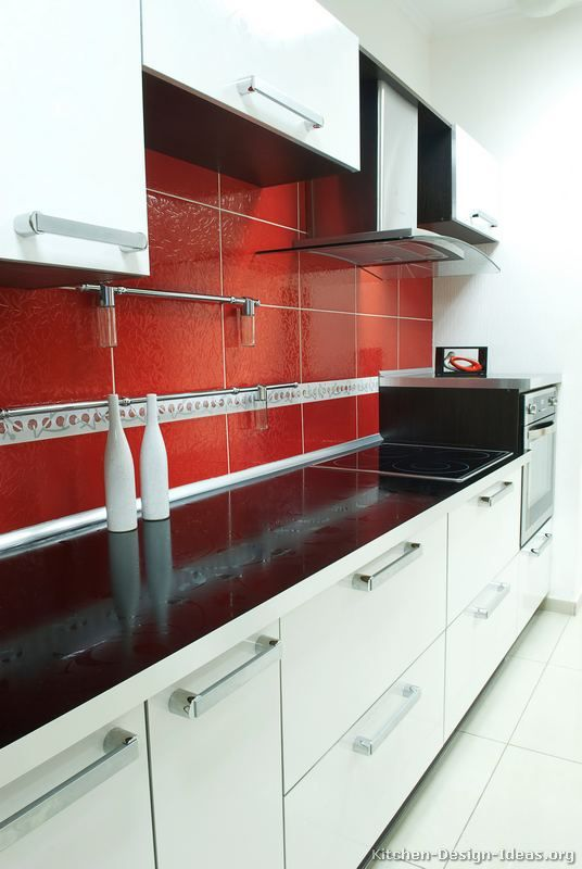 Kitchen idea of the day modern white kitchen with a red for Red and black kitchen backsplash