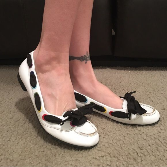 BOGO Betseyville flats Cute white flats with ribbon detail. Leather. Excellent condition.  Now included in the BOGO sale! ** equal or lesser value item free. Only applies to designated BOGO items Betsey Johnson Shoes Flats & Loafers