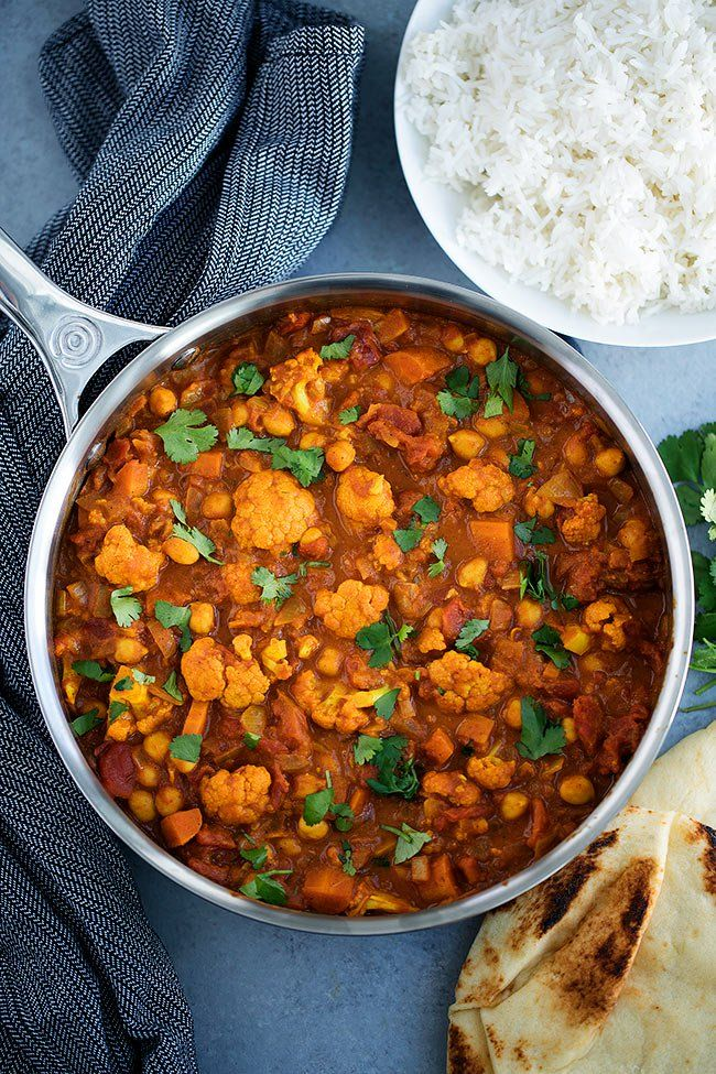 Vegetarian Tikka Masala That Is Made With Cauliflower, Chickpeas, And A Rich Creamy Tomato Sauce. Serve With Basmati Rice And Naan Bread For A Delicious Indian Dinner At Home.