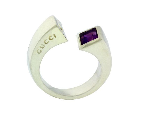 www.jewelrybydavid.com Gucci amethyst twist ring in sterling silver new in box Size 6.75. Link to the item https://www.jewelrybydavid.com/collections/gucci/products/gucci-amethyst-twist-ring-in-sterling-silver-new-in-box-size-6-75
