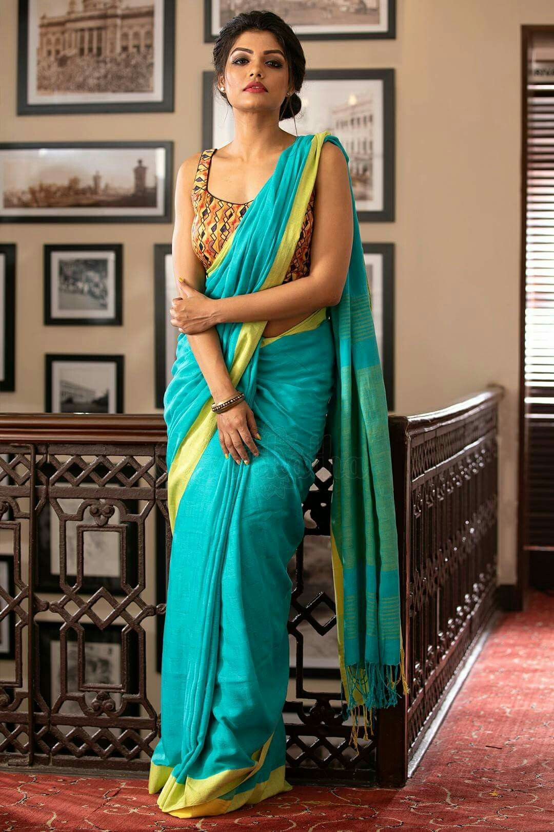 54d4f131b142b Sea green linen saree paired with a heavily embroidered contrast blouse