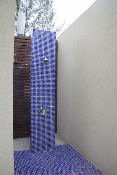 An Outdoor Shower With Bright Blue Tile   An Interesting #pool Rinse Off  Idea
