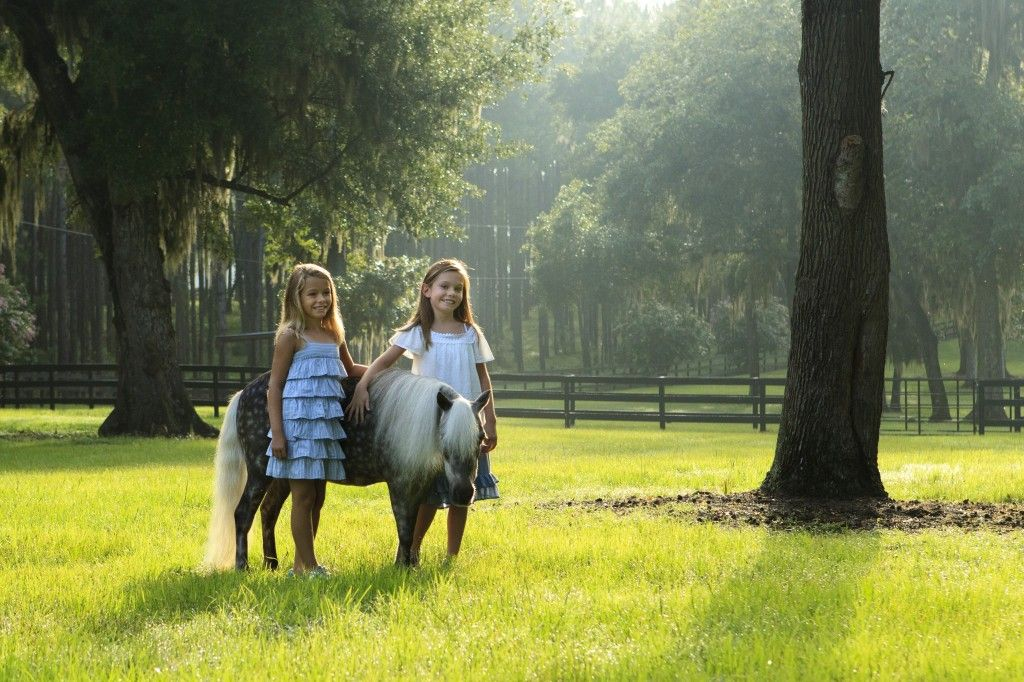 Girls and miniature horse