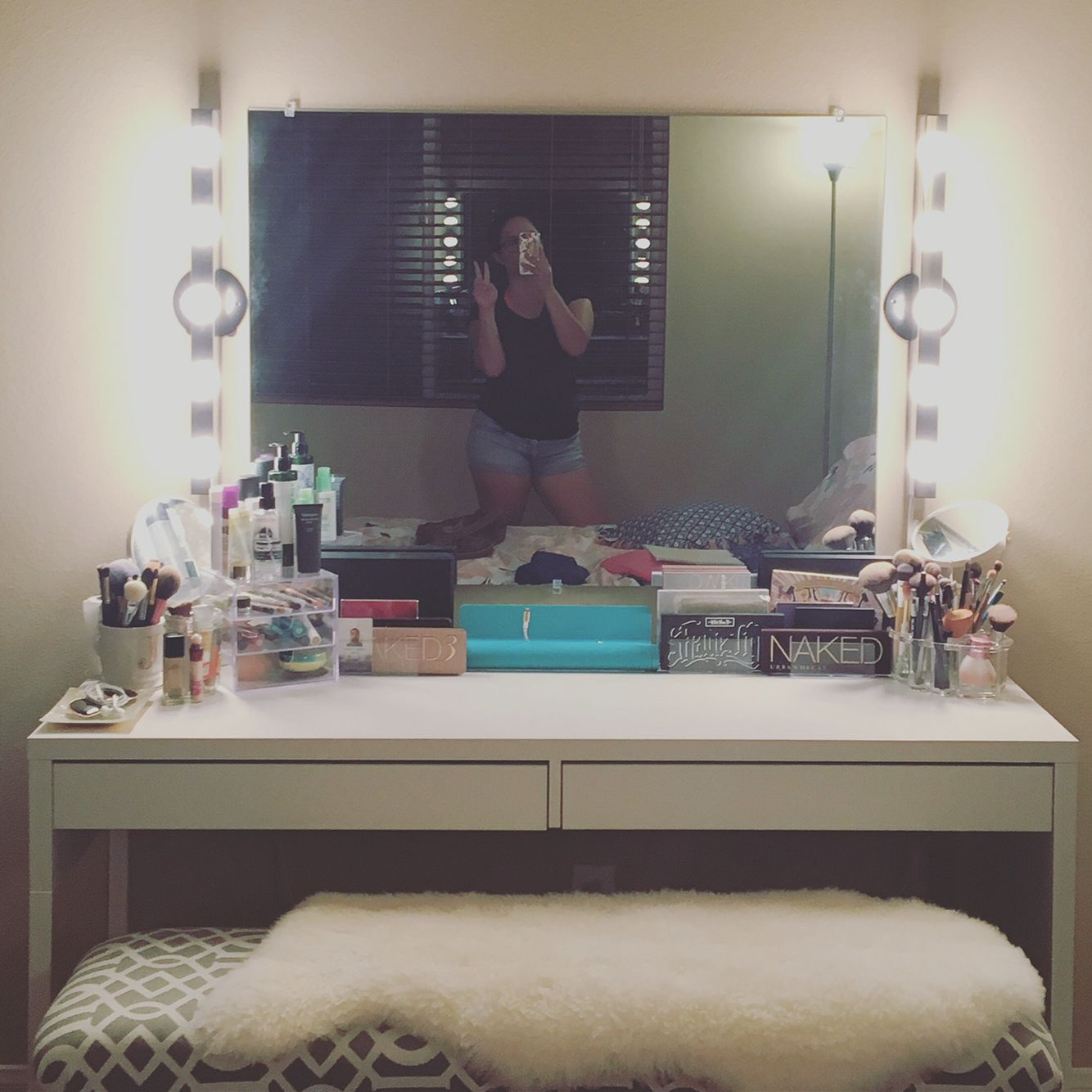 DIY Vanity! Mirror from Lowes, light fixture from IKEA, desk from IKEA, bench was reupholstered using fabric and cushion from Joanns, fur from IKEA