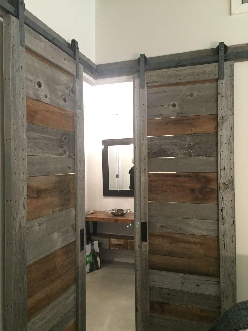 Custom barn door made of barn boards for corner bedroom in for Custom barn doors