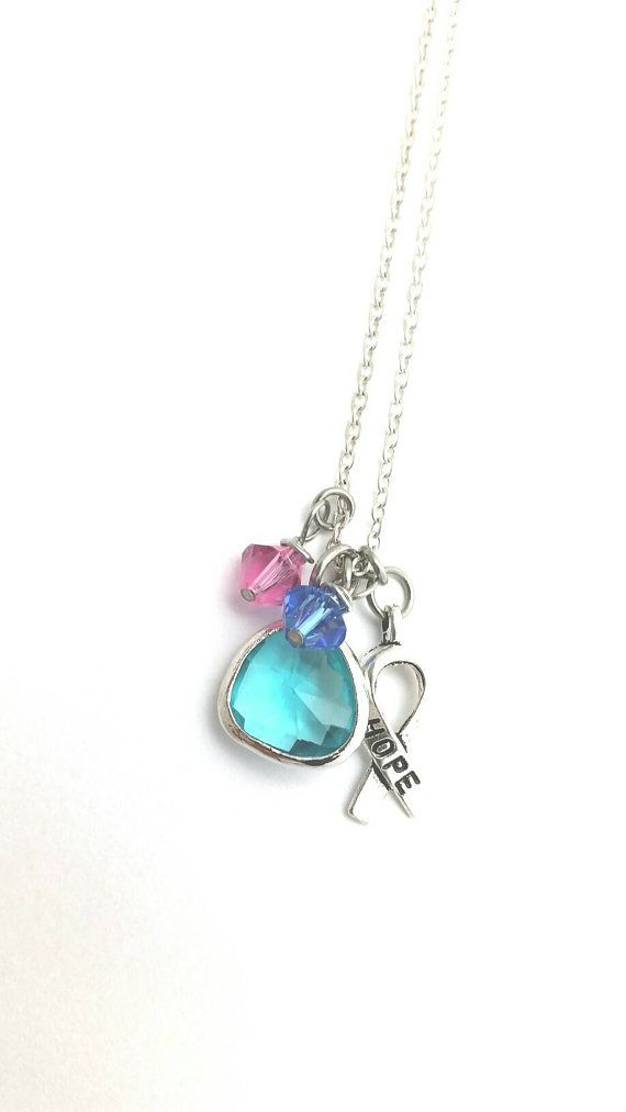 Thyroid cancer awareness,teal pink blue Hey, I found this really awesome Etsy listing at https://www.etsy.com/listing/468304039/thyroid-cancer-awareness-necklacethyroid