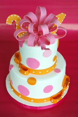 Adorable pink and orange polka dot birthday cake gotta try to