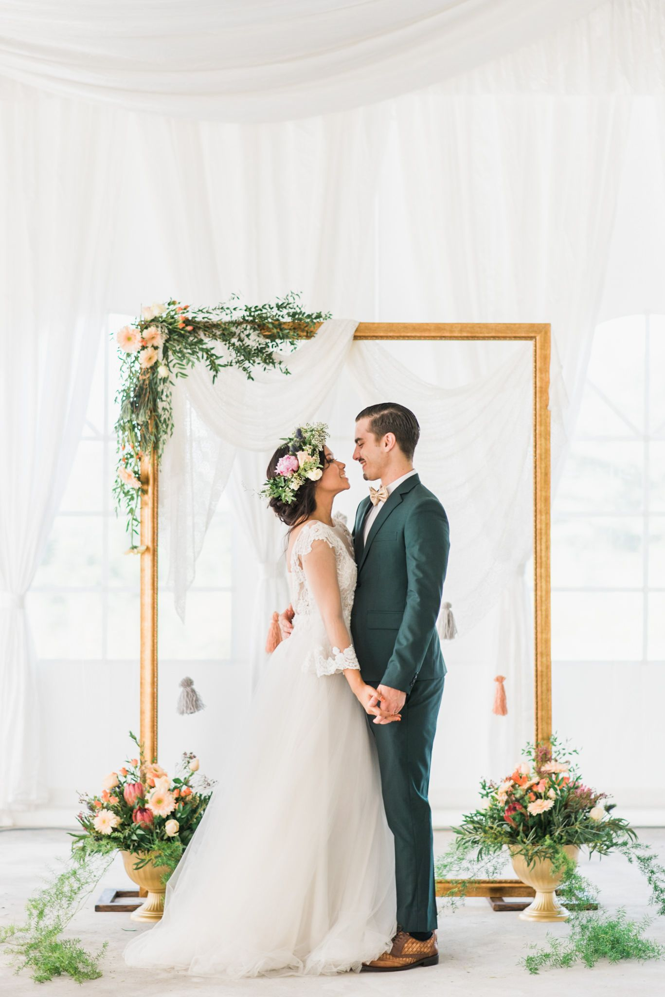 Gold frame wedding backdrop accented with rustic flowers // Bohemian ...