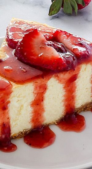 Rich and creamy, this classic New York-Style Cheesecake gets gussied up with fresh strawberry sauce.