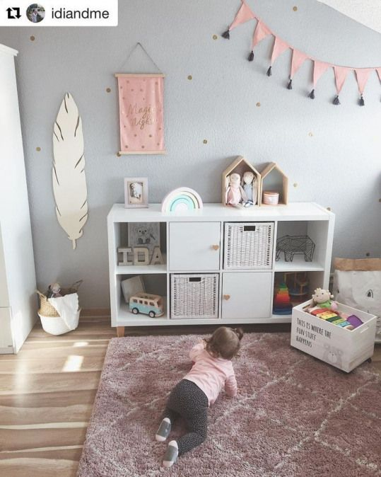 An enchanting childrens room with IKEA Kallax and heart furniture buttons in nature